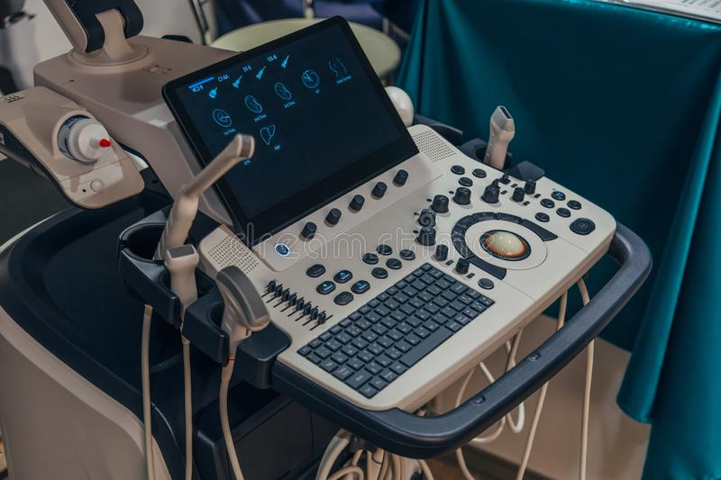 Modern ultrasound machine in clinic laboratory of sonography diagnostics.  royalty free stock image