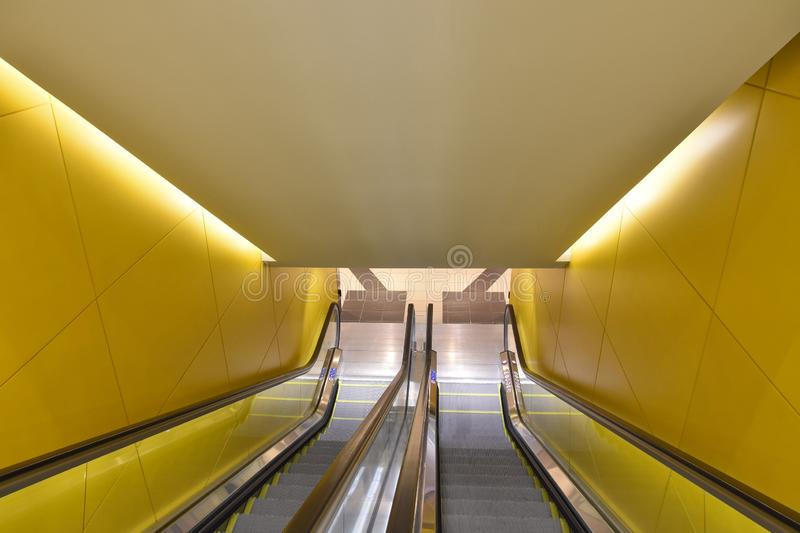 Modern underground station passage with escalators stock photography