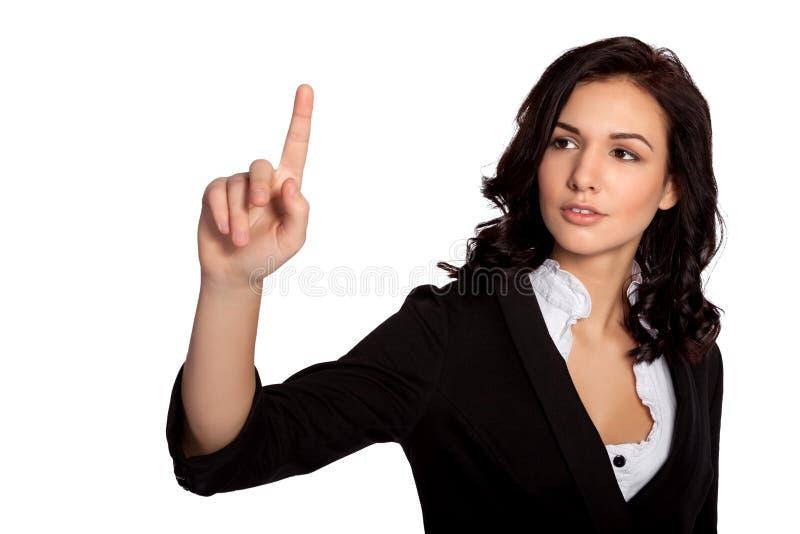 Modern ung härlig affärskvinna som pekar grafframsteg i luften fotografering för bildbyråer