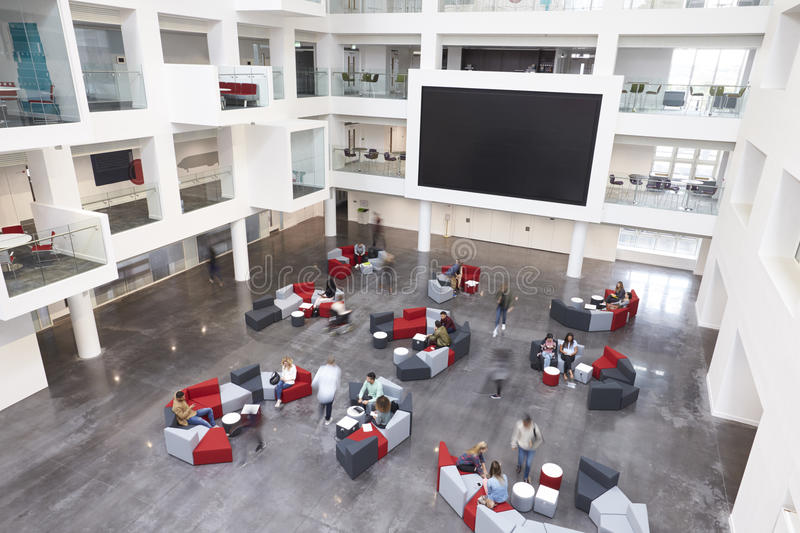 Modern university lobby atrium and glass fronted study rooms royalty free stock images