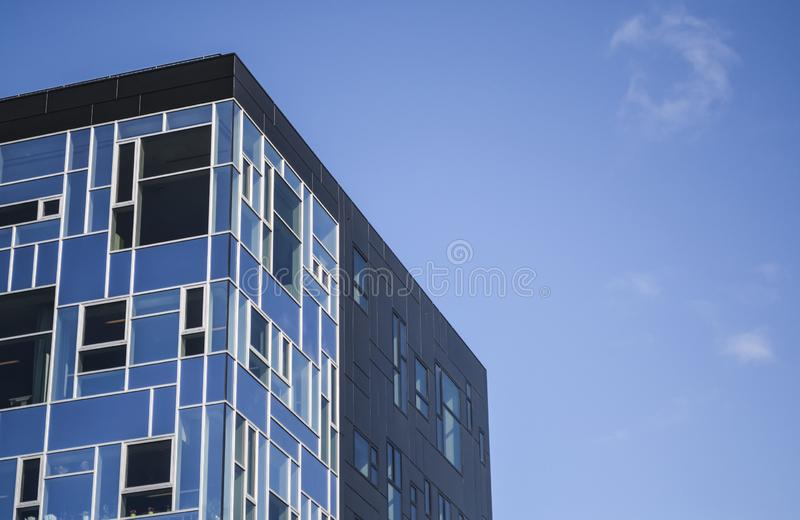 Modern and unusual architecture from metal and glass. Non-standard forms and decisions. Lines and geometry of the big building. stock photos