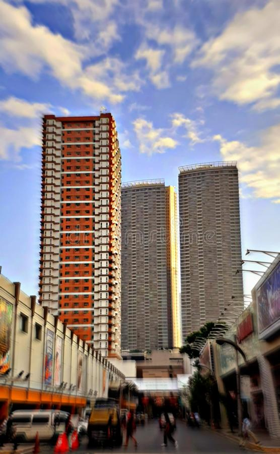 Modern urban apartment and residential buildings. Blur, couds, sky, people stock photography
