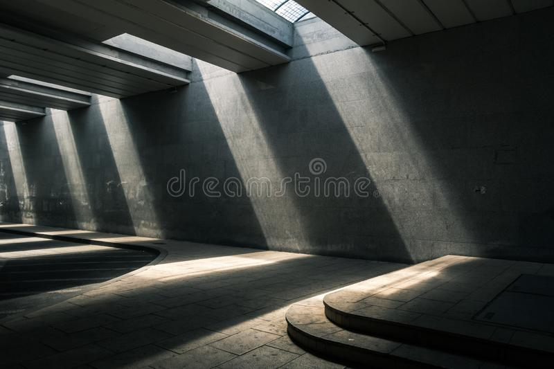 Modern urban passage with dramatic light. In mid day. Concrete royalty free stock images