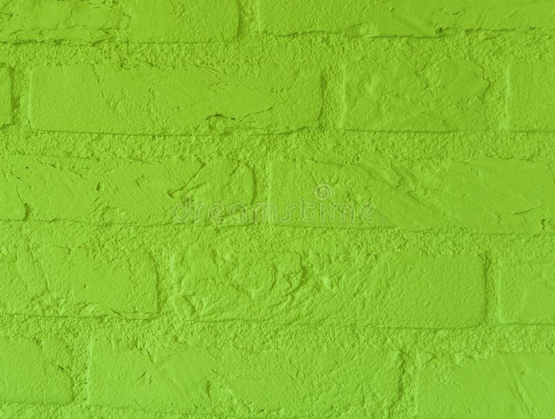 Modern vibrant Lime green stone brick wall with big bricks close up vintage background pattern stock photo