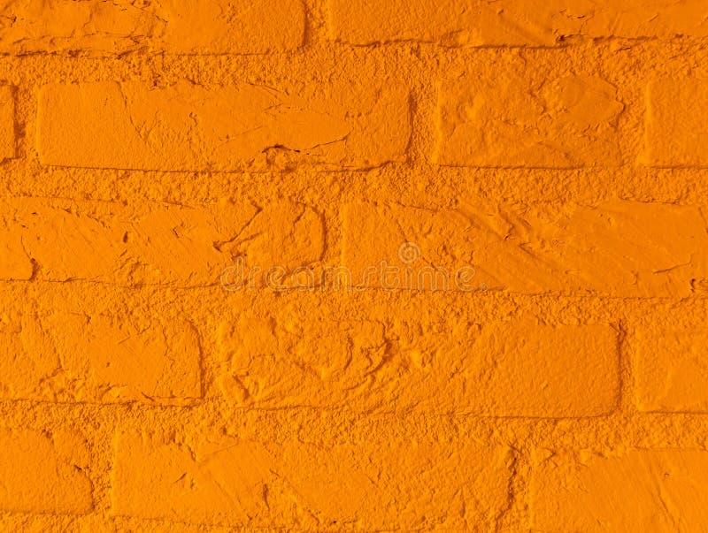 Modern vibrant orange stone brick wall with big bricks close up background pattern royalty free stock photography