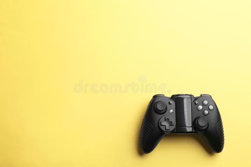 Modern video game controller on color background stock images