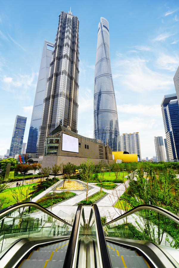 Modern view of skyscrapers and park in business center, Shanghai. Modern view of skyscrapers and park, the Pudong New District, Shanghai, China. Escalator stock images