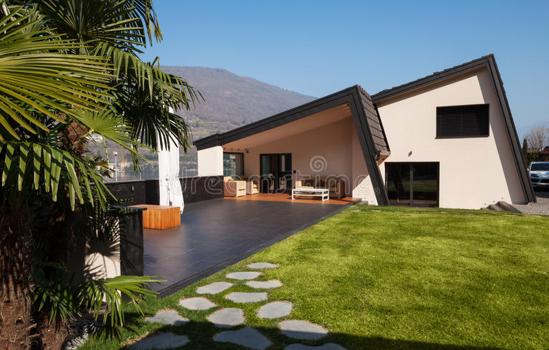 Modern villa, exterior with lawn, nobody stock images