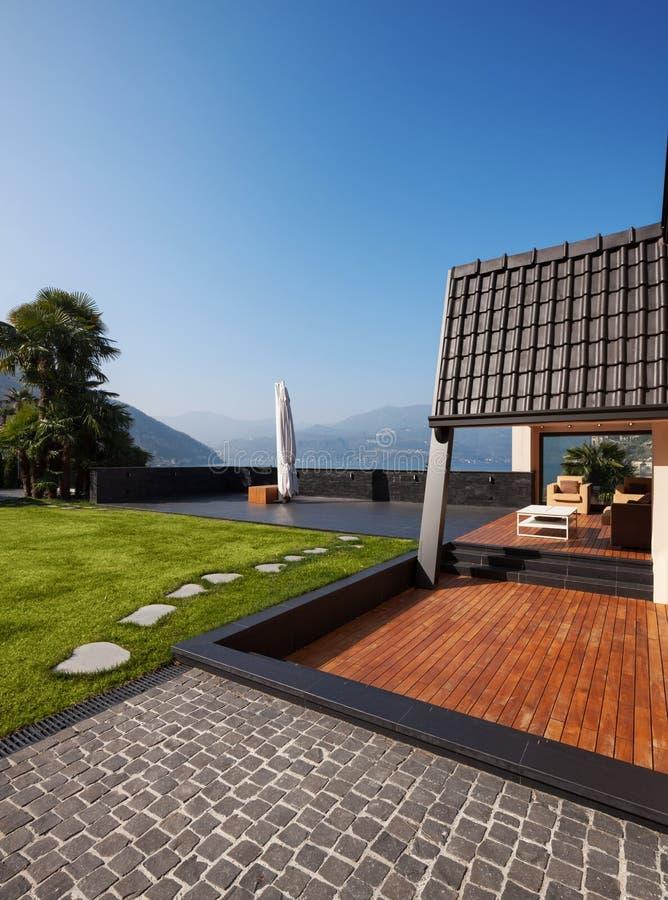 Modern villa, exterior with lawn, nobody stock photo