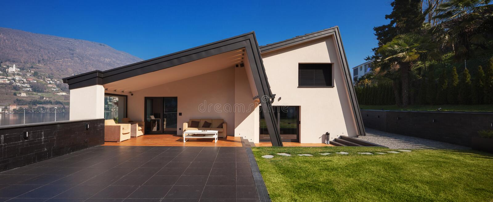 Modern villa, exterior with lawn, nobody royalty free stock photography