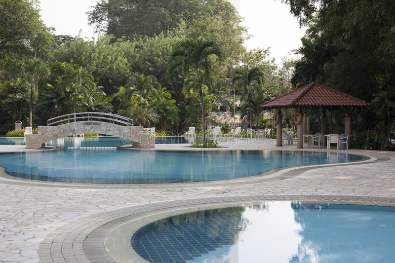 Modern villa outdoor with swimming pool and gazebo. In Singapore stock photos