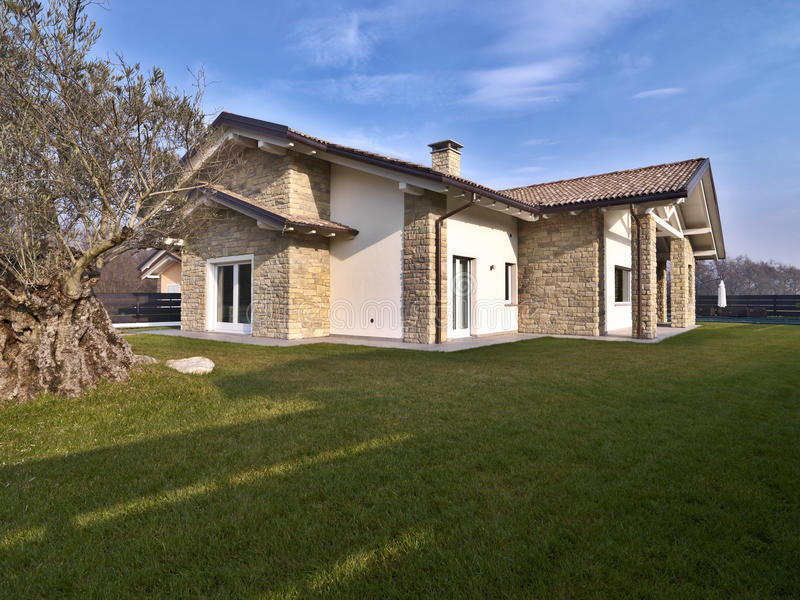 Modern villa with stone walls stock photo image of for Interni di ville moderne