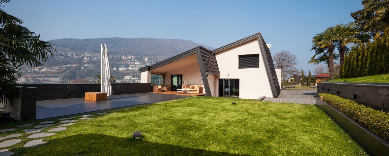 Modern villa, view with garden stock photos