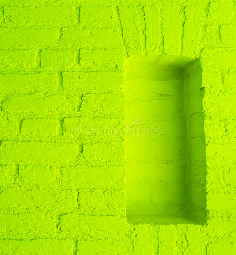 Modern vintage lime green stone brick wall texture background with empty window frame work stock photo
