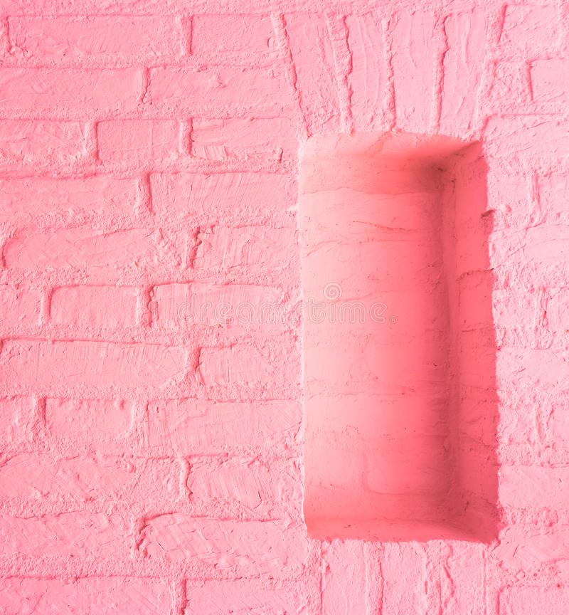 Modern vintage soft light pink stone brick wall background with empty window space royalty free stock images