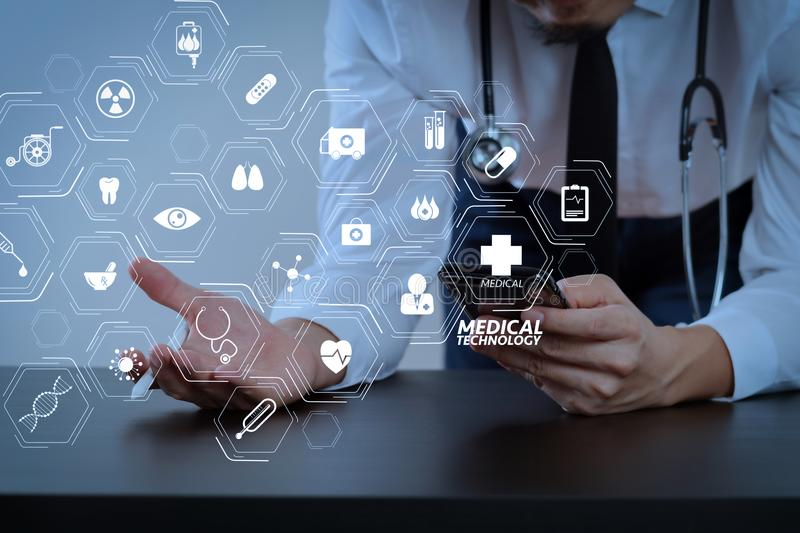 Close up of smart medical doctor working with smart phone and st. Modern VR with medical technology diagram concept.close up of smart medical doctor working with royalty free stock photos