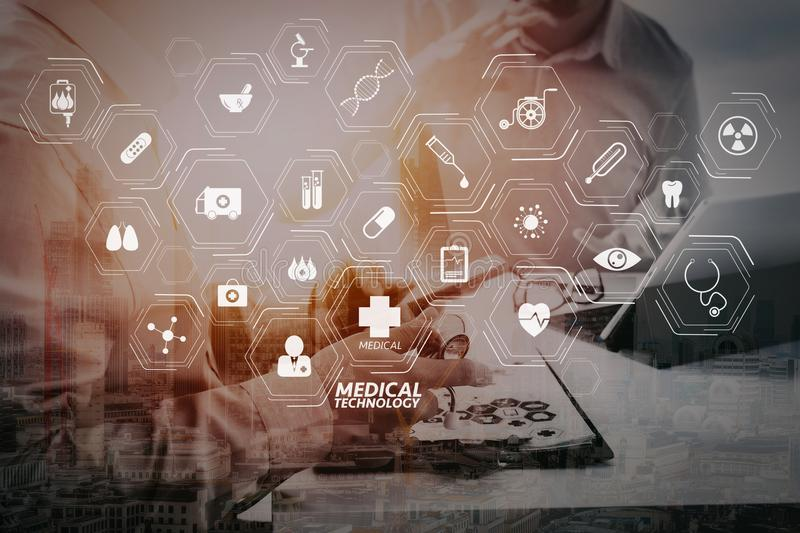 Medical doctor using mobile phone and consulting businessman pat. Modern VR with medical technology diagram concept.Medical doctor using mobile phone and stock photography