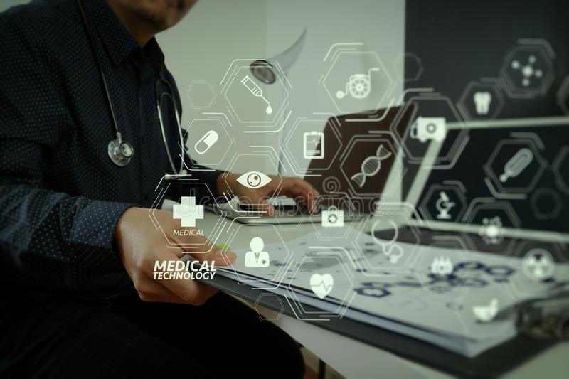 Smart medical doctor working with smart phone and digital tablet. Modern VR with medical technology diagram concept.smart medical doctor working with smart phone royalty free stock image