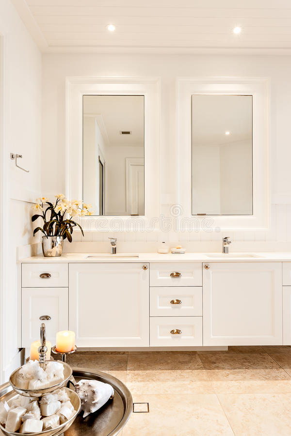 Modern washroom with two mirrors in a luxury house stock photos
