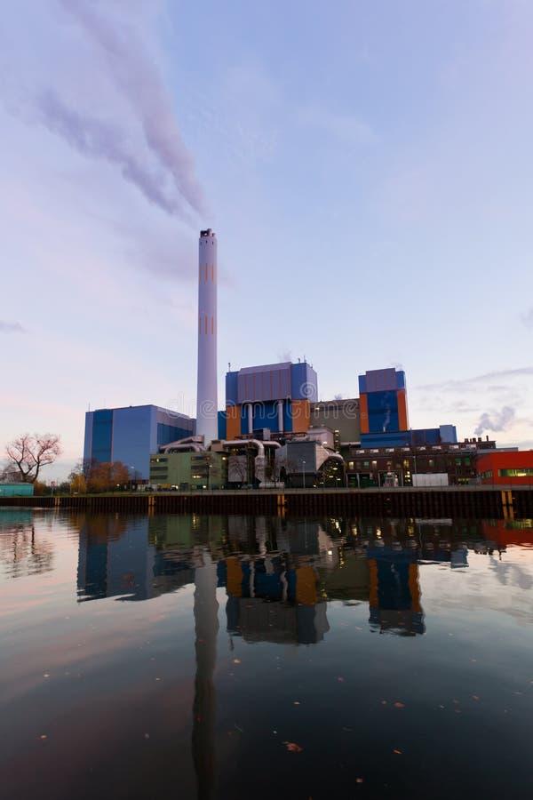 Modern waste-to-energy plant Oberhausen Germany. Building complex of modern waste-to-energy facility mirrored on water surface of Rhein-Herne-Kanal in Oberhausen royalty free stock photos