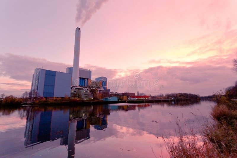 Modern waste-to-energy plant Oberhausen Germany. Building complex of modern waste-to-energy facility mirrored on water surface of Rhein-Herne-Kanal in Oberhausen royalty free stock images