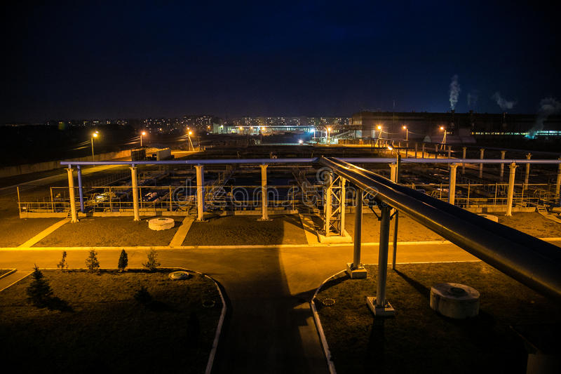 Modern wastewater treatment plant of chemical factory at night.  stock photography