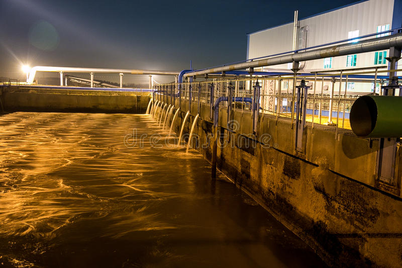 Modern wastewater treatment plant of chemical factory at night. Water purification tanks royalty free stock photo