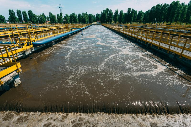 Modern wastewater treatment plant. Tanks for aeration and biological purification of sewage. By using active sludge stock photo