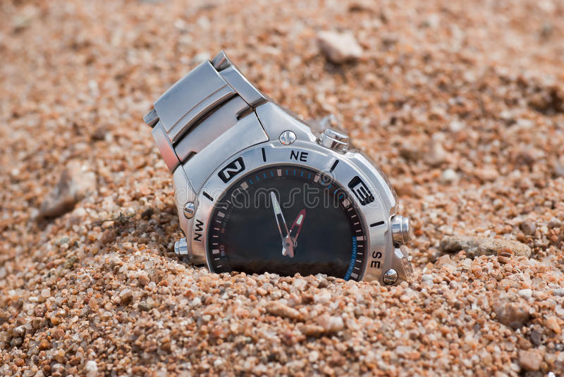 Modern watch in the sand stock image