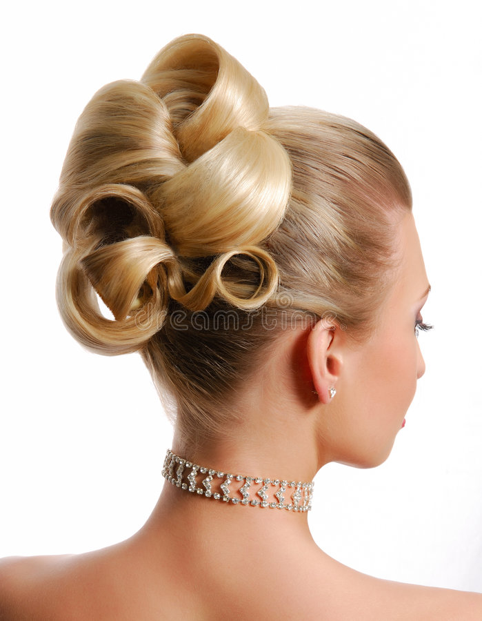 Modern wedding hairstyle. Beauty wedding hairstyle rear view isolated on white stock photo