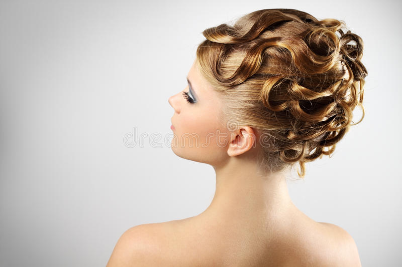 Modern wedding hairstyle. on gray stock images