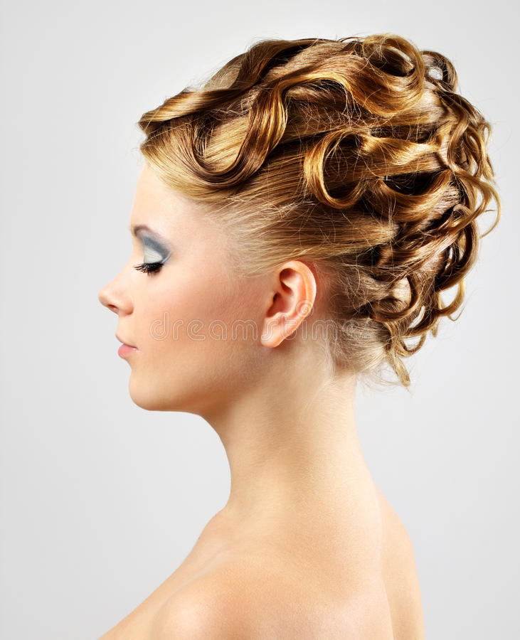 Modern wedding hairstyle. on gray royalty free stock image