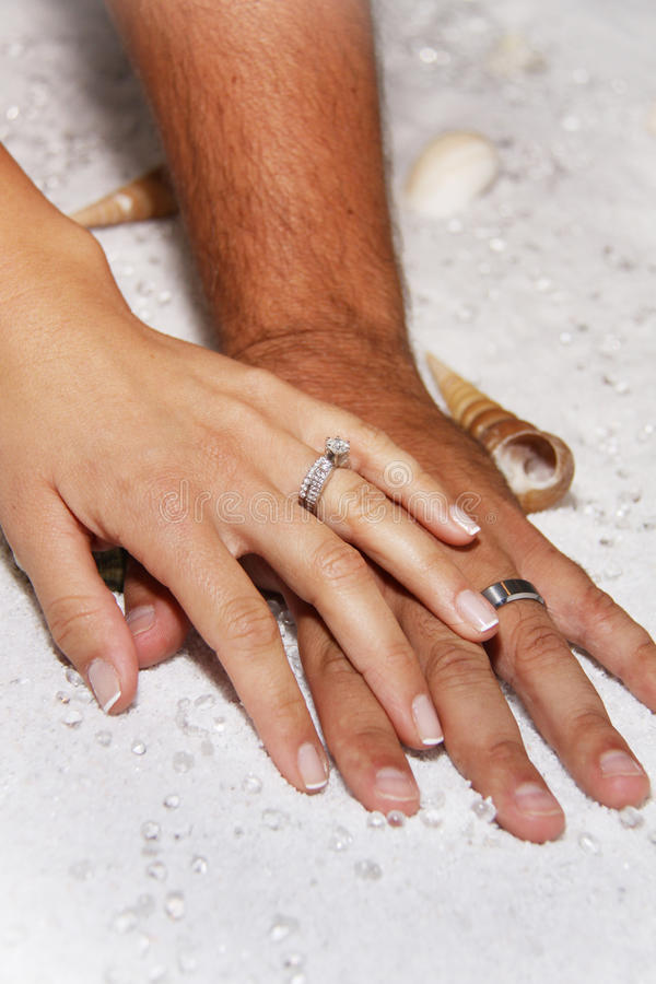 Modern Wedding Hands In White Sands Royalty Free Stock Photography