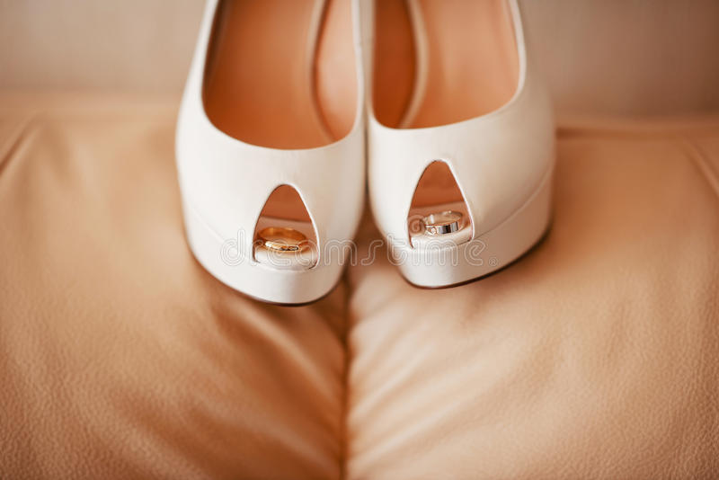 Modern wedding shoes. A pair of modern white wedding bridal shoes stock images