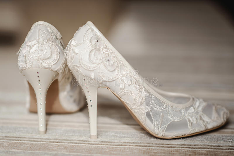 Modern wedding shoes. A pair of modern white wedding bridal shoes royalty free stock image