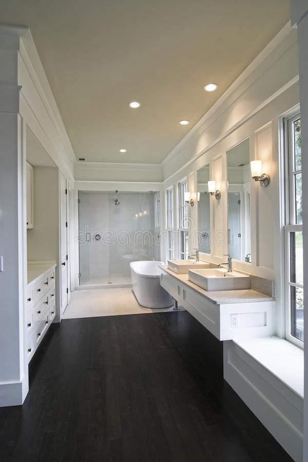 Modern white bathroom. With double sinks, tub, and shower royalty free stock photography
