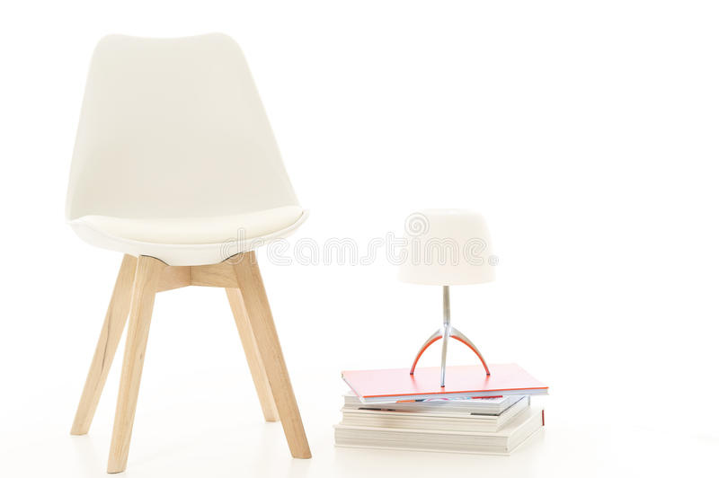 Modern White Chair and Lamp in Studio royalty free stock photos