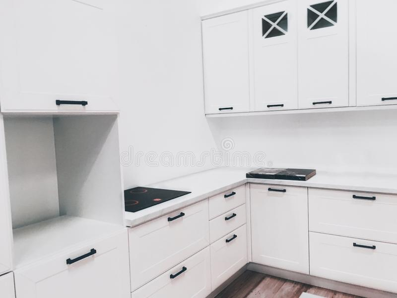 Modern white colored kitchen interior stock images