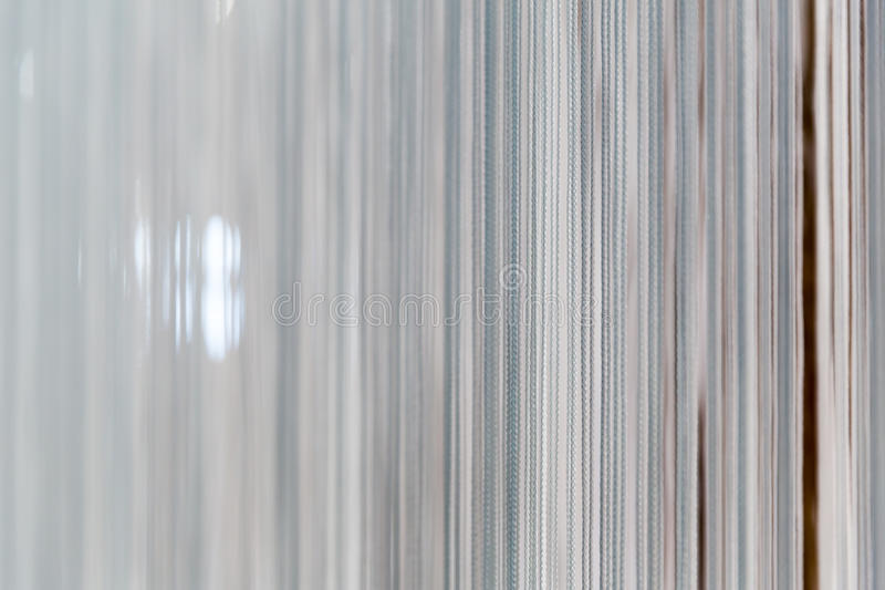 Modern white curtain. With many strands royalty free stock image