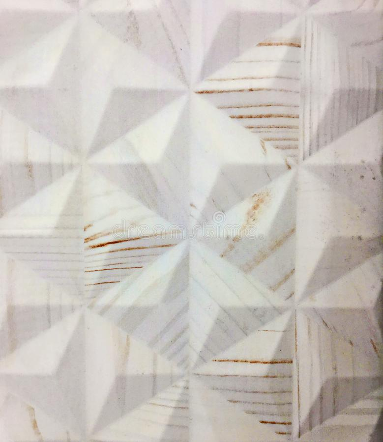 White Ceramic Tile in a Geometric Triangle Pattern royalty free stock photography