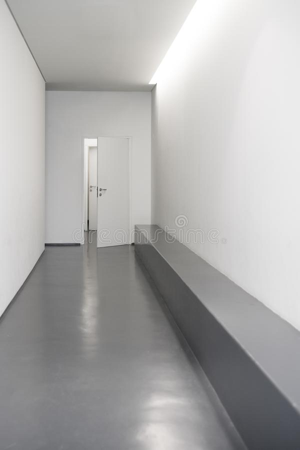 Modern white hallway with doors stock images