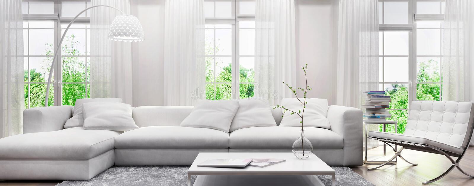 Modern white interior with a sofa and large windows stock image