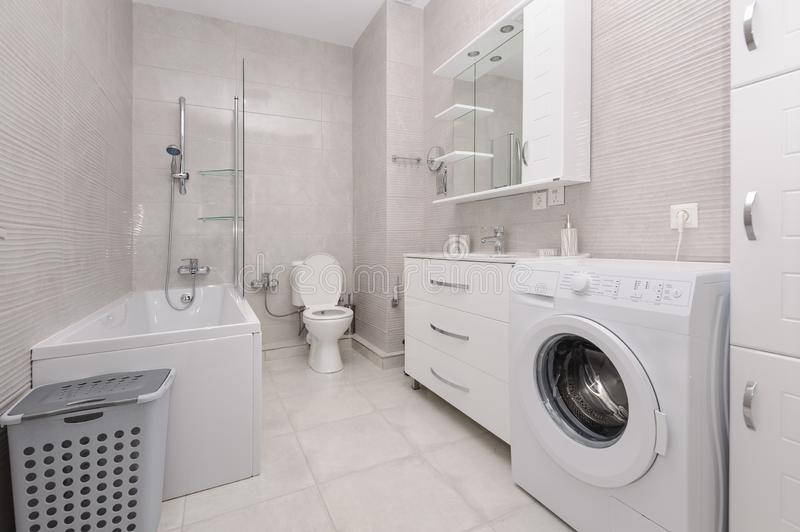 Modern white and kight beige bathroom. Interior stock images