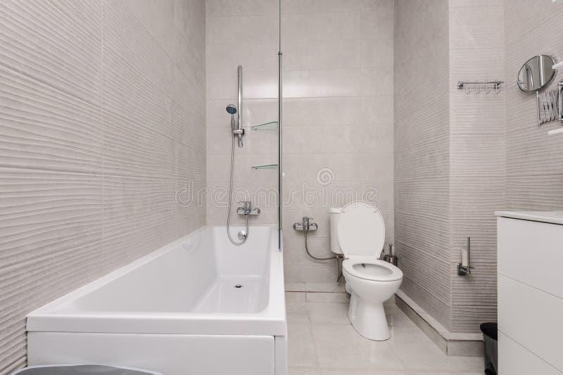 Modern white and kight beige bathroom. Interior stock image