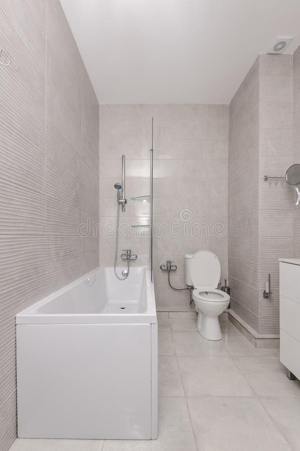 Modern white and kight beige bathroom. Interior royalty free stock images
