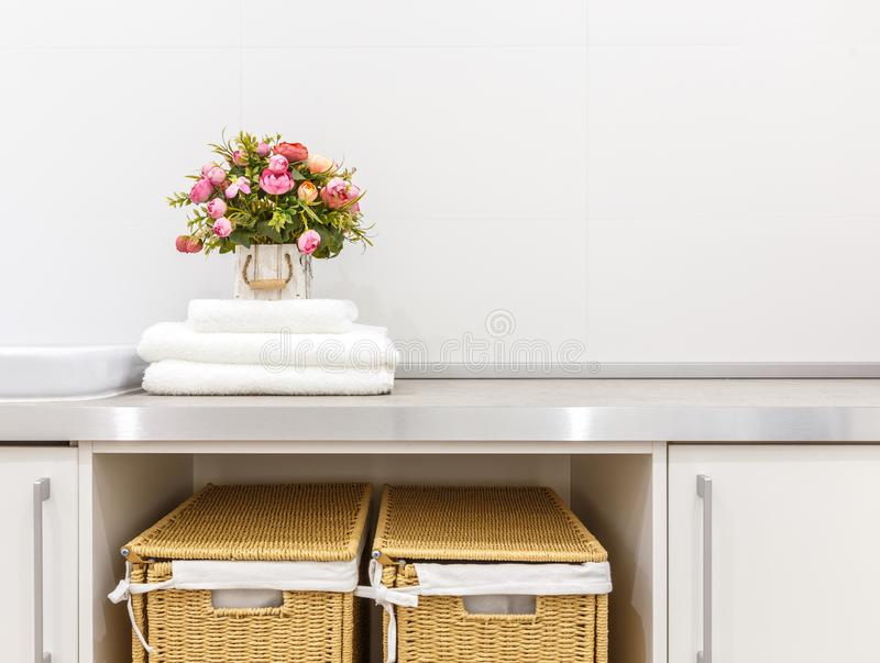 Modern white laundry room with two baskets stock photography