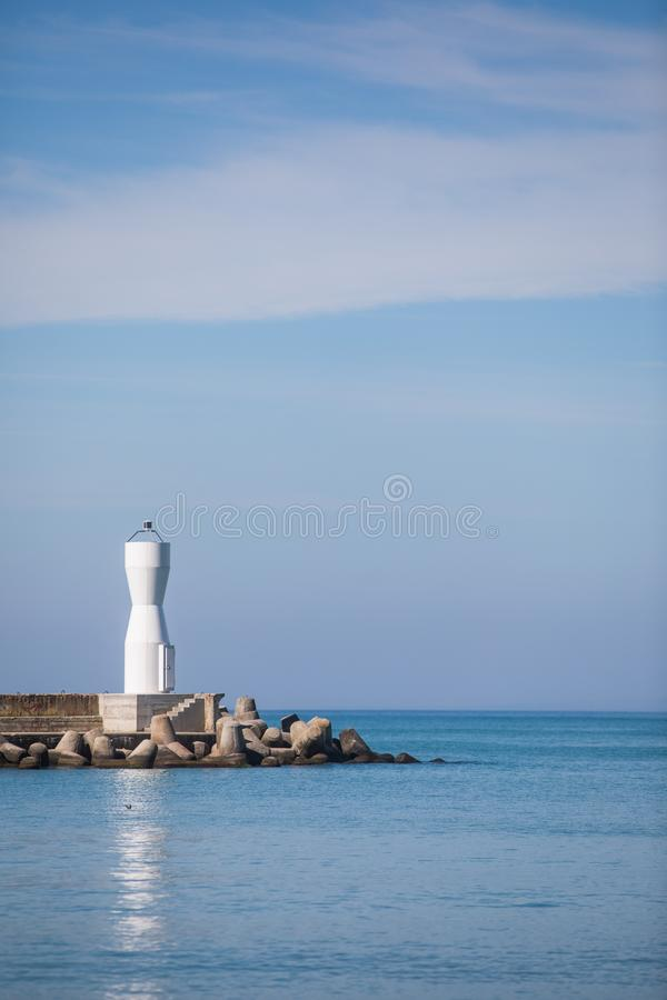 Modern white lighthouse royalty free stock photography