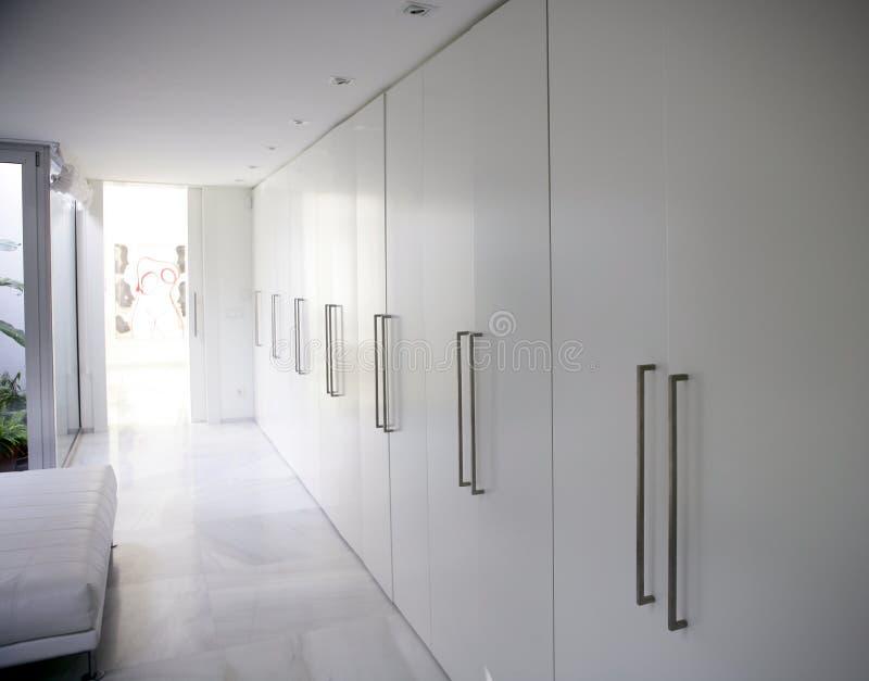 Modern white long corridor closet, contemporary stock images