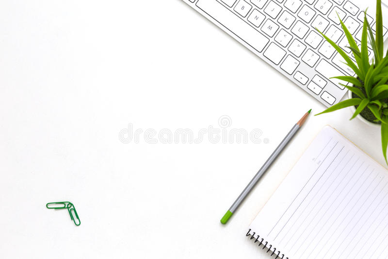 Modern white office desk flat lay with business items and plant stock image
