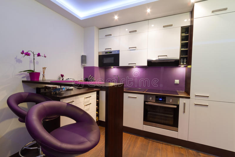 Modern white and purple kitchen royalty free stock photo